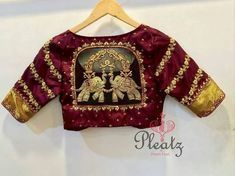 10 Latest Maroon Saree Blouse Designs to Try - - Maroon is a very auspicious colour and this is why the colour is popular in Indian ethnic wear. We've compiled the list of the latest maroon blouse designs for sarees and lehengas. Maroon blouse ca…. Pattu Saree Blouse Designs, Fancy Blouse Designs, Bridal Blouse Designs, Sari Blouse, Saree Dress, Dress Designs, Blouse Back Neck Designs, Stylish Blouse Design, Hand Work Blouse Design