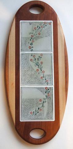 a handmade cheeseboard, with tiles from artist Debra Bures