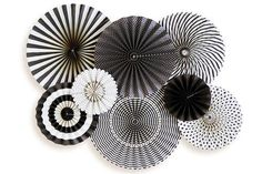 These black & white paper fans are the perfect addition to your upcoming celebration. Printed paper includes classic polka dots, stripes and more. Use as decorations for your event, create a fun desse