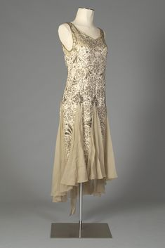 Beaded evening dress of cream satin and chiffon, American, late 1920s, KSUM 1983.1.341.