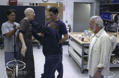 Special Effects Character Creators Rob Ramsdell and Jason Matthews show Stan Winston the progress of the hero animatronic rod puppet from DARKNESS FALLS.