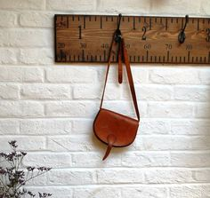Our stunning handmade vintage style coat hooks are designed as giant rulers and are made to order.These are available with 2 hooks (60cm) 3 hooks (90cm) and 5 hooks (180cm).These original coat hooks have a quirky edge to them – designed as a giant vintage ruler with Victorian style iron hooks, you can teach your kids all about metric/imperial conversions whilst getting them to tidy up after themselves too! Hand stained and hand stencilled, these will add an original twist to any cloakr...