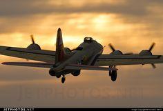 B-17G climbs into the evening sky -