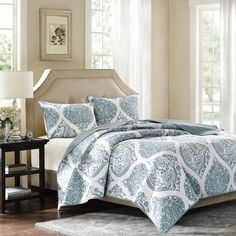 Create an elegant space in your bedroom with the harbor house ogee paisley coverlet. This beautiful cotton coverlet features a repeating ogee pattern in dusty blue with an intricate paisley motif in the center of the ogee.