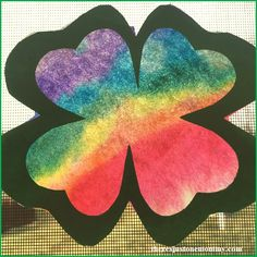 This rainbow shamrock suncatcher is the perfect kids St. Patrick's Day craft to add a touch of spring to your windows.