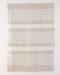 Part of our Blanc + Noir Collection, this traditional striped pattern reminds us that life is delicious - a very nice sentiment for your kitchen. The
