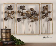 Metal Tulips, S/3  This set of decorative wall art is made of hand forged metal finished in antiqued gold leaf with a charcoal gray wash. Sizes: Sm-10x27x4, Lg-20x27x4