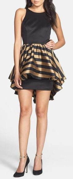Such a fabulous gold and black party dress #wedding #dress #gold #goldblack #cocktaildress