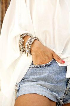 Denim shorts and bracelets.