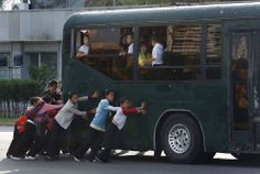 North Korean children push a bus in a street in Pyongyang, on September 20, 2012. (AP Photo/Vincent Yu) #