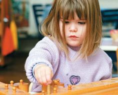 NAMC repetition in the montessori environment girl knobbed cylinders