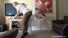 Big butt woman in short ass revealing massage uniform, black pantyhose and heels giving guy a sexy body massage. Big arse women in pantyhose arses butt booty woman in tights.