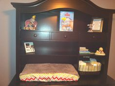 Dumbo book on display. Also, Jim Shore Dumbo figurine in both corners.