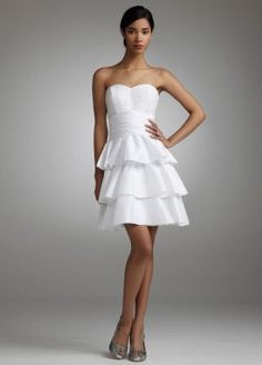 Something simple but cute for bridesmaids. not necessarily white, any color you want. but the short look with the strapless top and a little flow to it to go with the nature of the beach and the water.