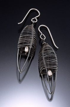Half-wrap Pod Earrings, oxidized silver with white pearl. $155.00, via Etsy.
