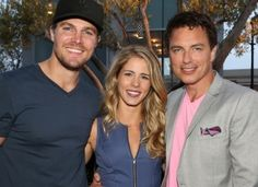 (L-R) ARROW stars Stephen Amell, Emily Bett Rickards & John Barrowman at the Warner Bros./DC Entertainment Comic-Con Party & Superman 75th Celebration #WBSDCC (©2013 WBEI. All Rights Reserved.)
