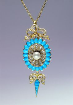 A Victorian necklace pendant with a large pearl centre stone and an array of diamonds and turquoise, set in 18ct gold. This piece is from the Victorian era and was most likely made around 1875.
