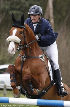 Zara, pictured riding her horse Fernhill Facetime, will run two other competitors in the weekend's event