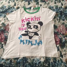 NEW LISTING  Panda/Ninja Graphic Tee (junior's) Barely used, needs a new, loving home ❤️ wrinkled due to storage. ⛔️ NO TRADES, NO PAYPAL, NO MERCARI, NO HOLDS ⛔️ smoke free, pet free home  let me know if you have other questions  PLEASE MAKE OFFERS THROUGH THE OFFER BUTTON. Tops