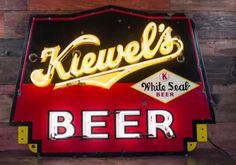 Kiewel's neon porcelain beer sign