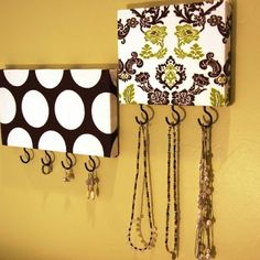 Cover wood with fabric and add hooks.