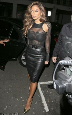 Nicole Scherzinger put her professional woes to one side as she headed out for a post-X Factor bite to ea...