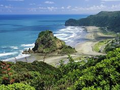 Piha Beach a good place to surf but needs caution for swimming due to the rips and deep holes caused by the surf and water flow constantly moving the sand. A real beautiful place in my home area of West Auckland, New Zealand.