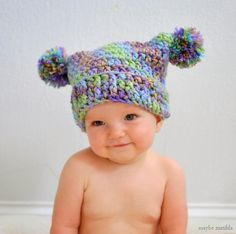 Free crochet pattern to make this adorable double pom pom hat!  (Not only is the hat adorable, but that baby!  Goodness!!)