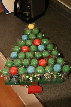 Cake Pop Christmas Tree...don't really love the pops themselves, but the holder is nice.  Might have to try to make myself something like that.