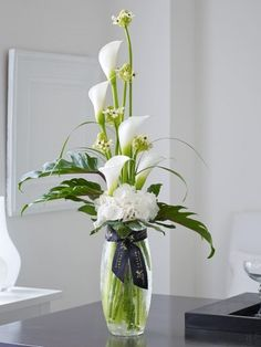 Featuring white saundersiae ornithogalum, white avalanche calla lilies and a whi. - Featuring white saundersiae ornithogalum, white avalanche calla lilies and a white snowball hydrang - White Flower Arrangements, Flower Centerpieces, Flower Vases, Flower Decorations, Artificial Floral Arrangements, Home Flowers, Luxury Flowers, Order Flowers, Flowers Garden