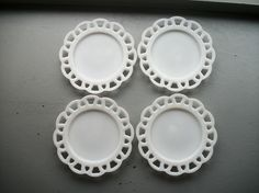milk glass plates, I have a few of these. I ran ribbon thru the holes and hung them on the wall