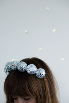 Perfect for New Year's Eve...Claim instant life-of-the-party status with this DIY disco-ball headband. #DIY