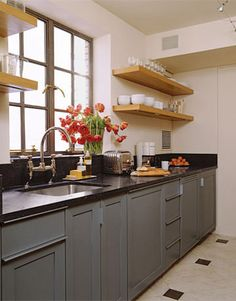 Small kitchen. I like the plain open shelves and the color of the cabinets.