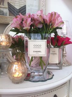 Chanel perfume vases in hallway www.thevintageroom.info