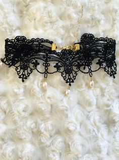 A dainty lace choker with tear drop pearls dangling from the ends. Because this product sells so fast it will be available for Pre-Order. Please allow 2-3 weeks for processing/shipment. Xo!