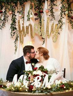 #finallydiveley finally happened!!! Can't believe this is a picture from my own wedding- looks like it belongs on Pinterest so here it is! Wedding sign, head table, sweetheart table, gold glitter, glitter sign, wedding greenery, garland, burgundy Marsala wedding
