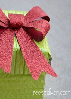 These fun, outdoor, holiday-decor gift boxes are a great DIY Christmas craft that will add some sparkle to your doorstep! Check out the tutorial here.