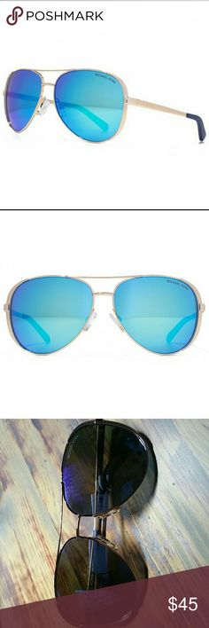 MK Gold Aviators Small scratch on the inside of lens, cannot see unless you hold up to the light not visible when looking at the glasses. Christmas present, lost the case. Retail for 85+ Michael Kors Accessories Glasses
