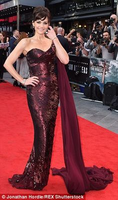 Lean and slender:Carla looked stunning in a maroon Georges Chakra gown with a long train...