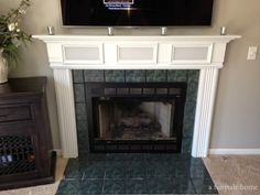 Fireplace redo Part 1. Built-in surround sound! No more ugly wall speakers!!! Need to replace green tile. Check it how we did this mantle renovation out on a fairytale home.