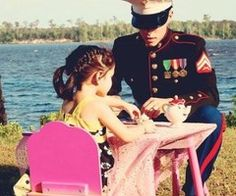 Military man playing tea party
