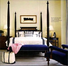 four poster bed with velvet bench at the end
