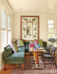 The suede-upholstered banquette in this Matthew Patrick Smyth–designed kitchen in the Hamptons encourages leisurely breakfasts.