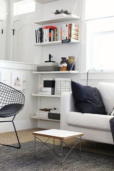 EKBY GÄLLÖ strikes again. Love the floor-to-ceiling set of shelves just floating there.