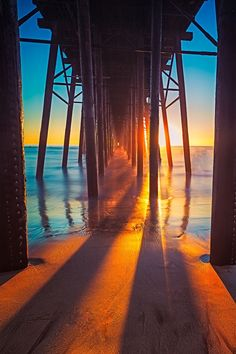 """""""Ocean, n. A body of water occupying about two-thirds of a world made for man — who has no gills."""" ~Ambrose Bierce, Artist~Oceanside pier by Evan Kokoska"""