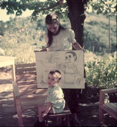 Francoise Gilot, mistress of artist Pablo Picasso, w. their young son Claude & holding drawings of the boy by Picasso.