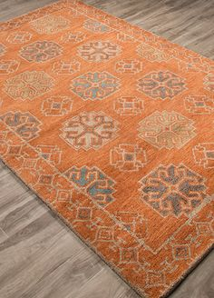 With a high-end look and luxurious feel, this plush-pile transitional rug defines versatility: Hand-tufted in 100 percent wool in shades of apricot orange and smoke blue, it's a transformative look that is easy care and easy-to-live with.