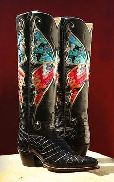 I've never been a fan of cowboy boots, mainly because of the super pointy toes,but these!  Rocketbuster Boots. LOVE them!