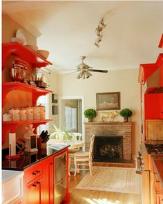 Love the use of orange in this kitchen!  #ppgorange