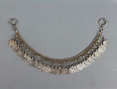 This is a forehead or turban ornament, likely from Iranian Kurdistan. With a band of interlocking flattened links, from which are suspended many coins. The coins are 1950s Iranian 1 Rials. ➡ http://ethnicjewels.ning.com/m/photo?id=5416612%3APhoto%3A402510&context=latest
